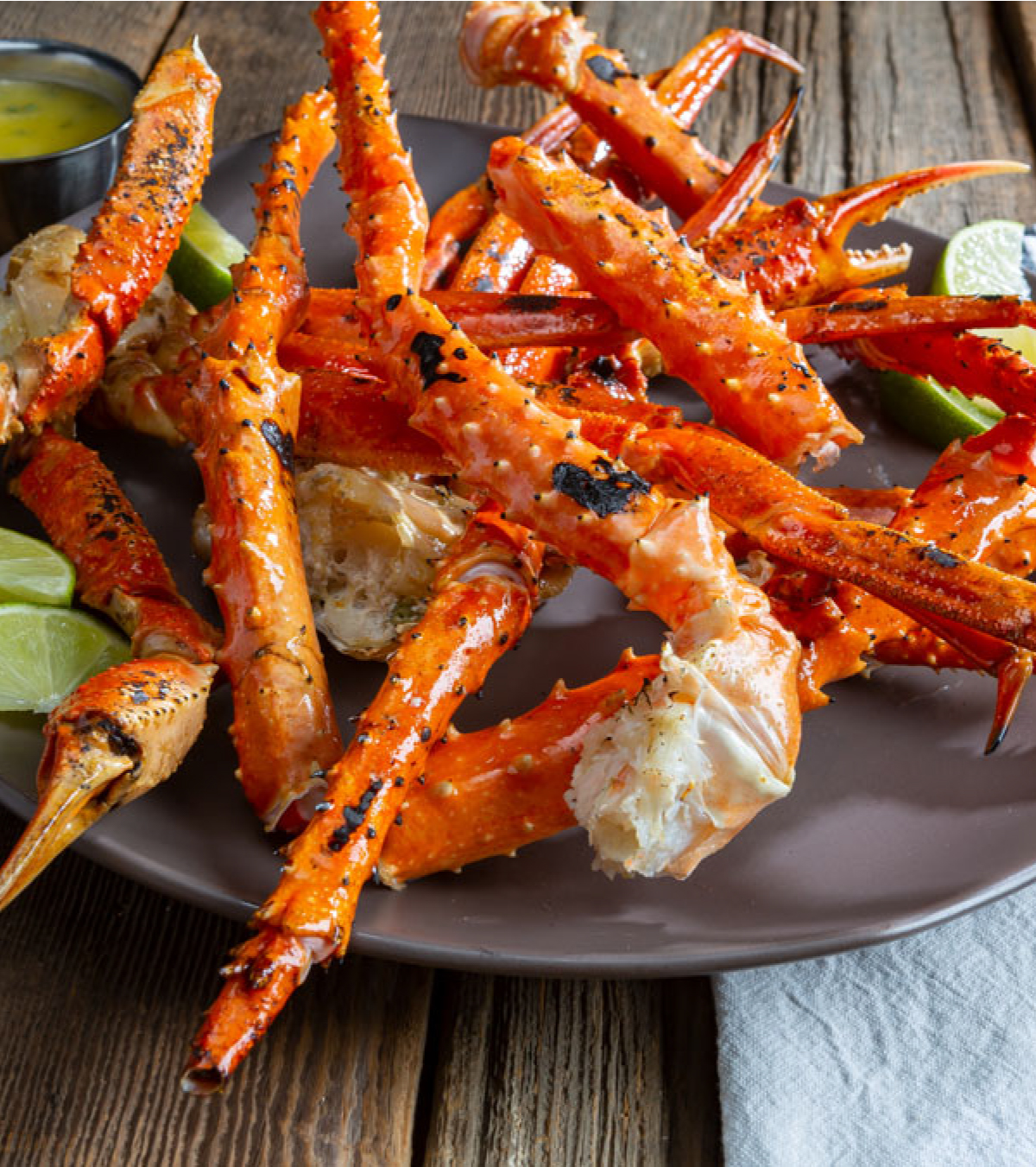 Grilled Crab Legs with Spicy Mustard Sauce & Basil-Lime Butter